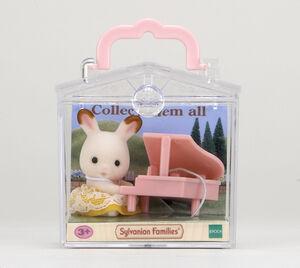 Sylvanian - Beb� para llevar conejo con piano